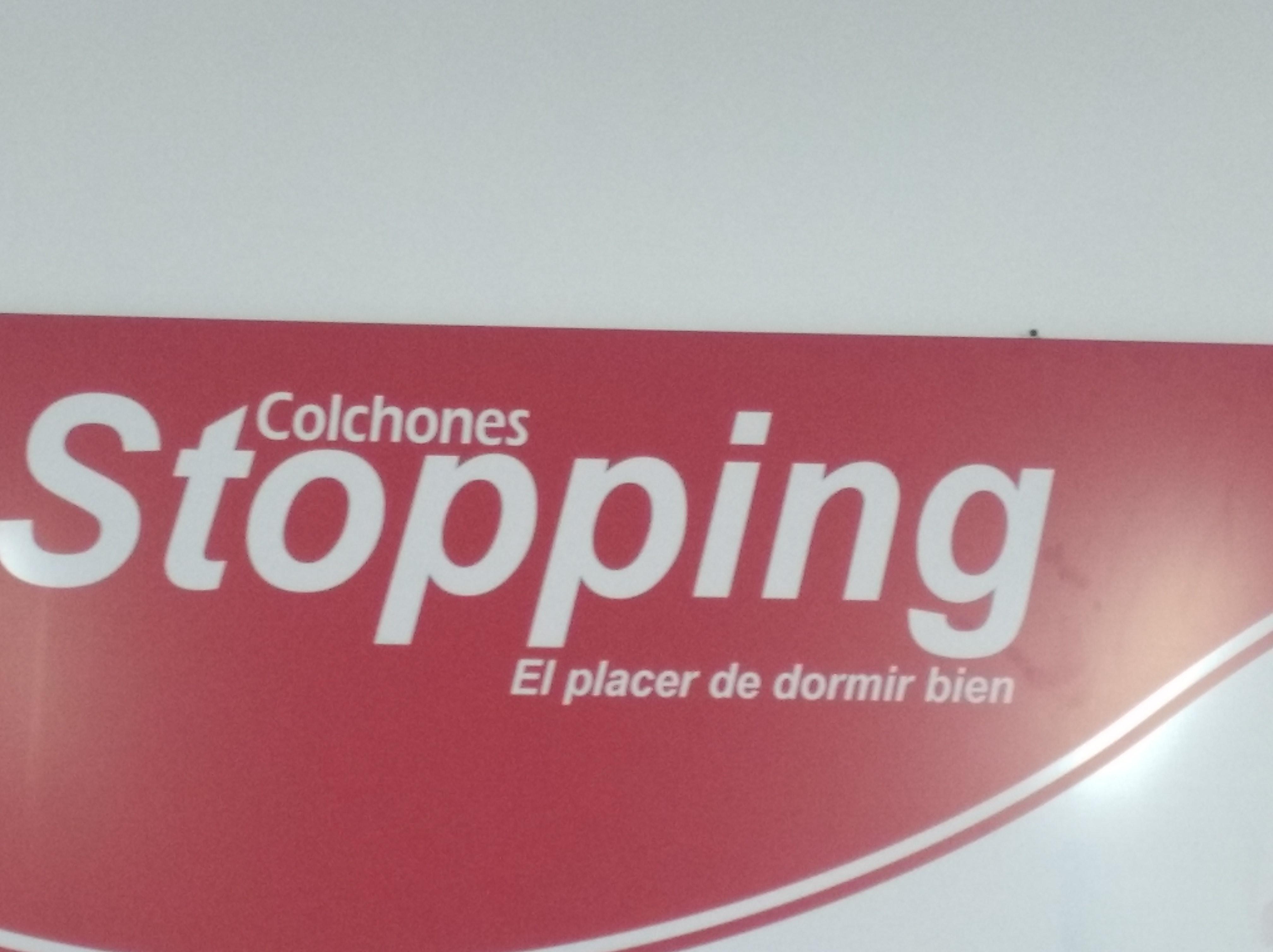 Logotipo de Colchones Stopping